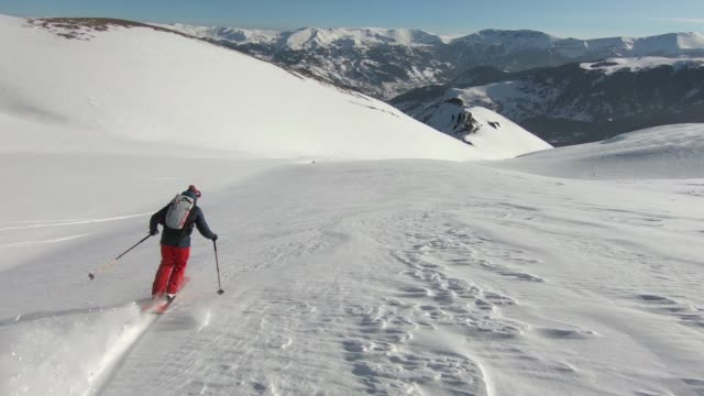 skiing snow powder down mountain - ski jacket stock videos and b-roll footage