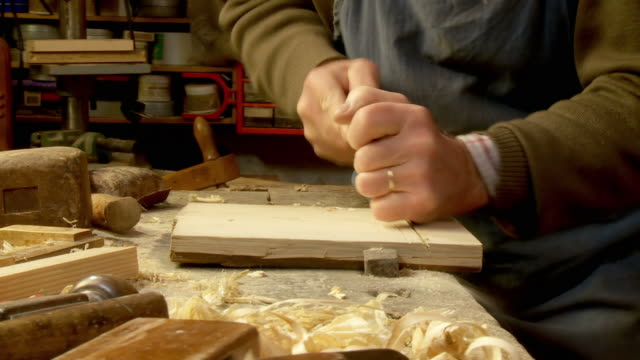 hd dolly: skilled carpenter - carving craft activity stock videos and b-roll footage