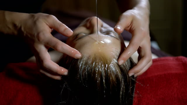skilled hands of ayurveda therapist - facial massage stock videos and b-roll footage