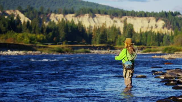 Skilled hobby female casting line freshwater fishing USA