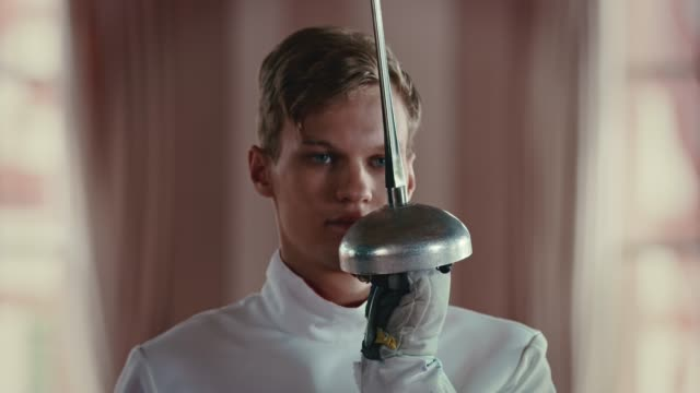skilled male fencer saluting with epee sword - fade in stock videos & royalty-free footage