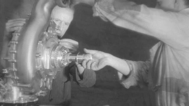 ms skilled steel workers testing steel engine components at the mill / united kingdom - 1931年点の映像素材/bロール