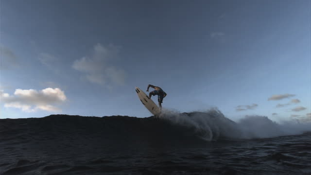 a skilled surfer leaps over an ocean wave. available in hd. - surfboard stock videos & royalty-free footage
