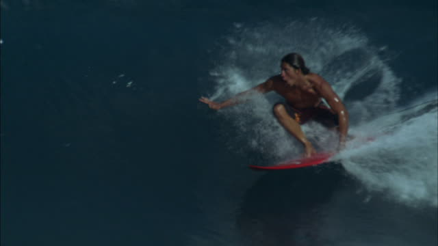 a skilled surfer rides a big ocean wave then falls off his board. - one piece swimsuit stock videos & royalty-free footage