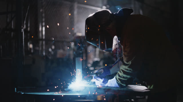 slo mo skilled welder uses welding torch to join metals together - metal industry stock videos & royalty-free footage