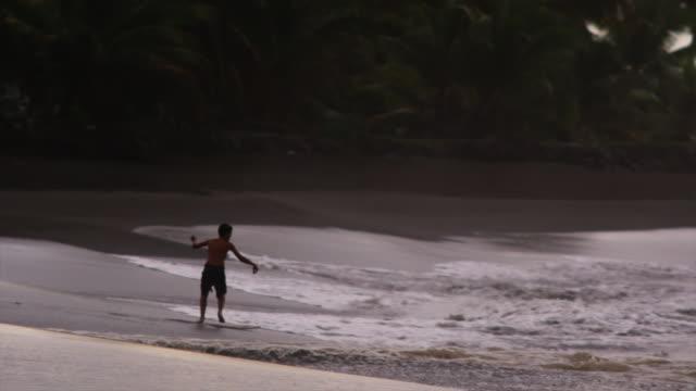 skim boarder - one teenage boy only stock videos & royalty-free footage