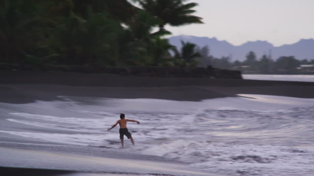 skim boarder - one teenage boy only stock videos & royalty-free footage