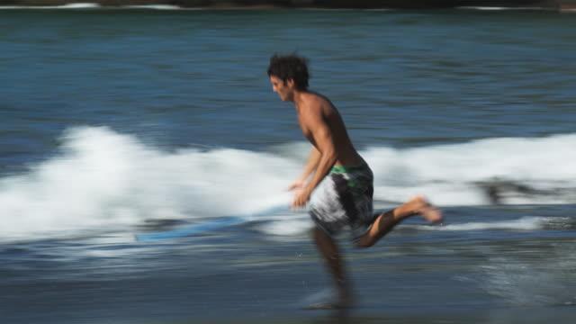 skim boarder - skimboarding stock videos & royalty-free footage