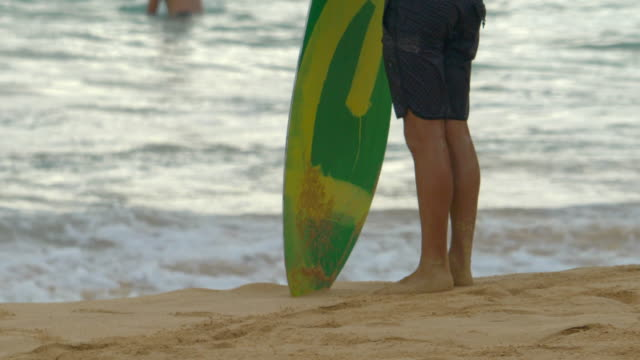 skimboarder going skimboarding surfing at sandy beach, oahu, hawaii. - slow motion - skimboard stock videos and b-roll footage