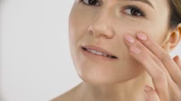 Skin Care. Mature Healthy Female Touching Face Skin With Hand