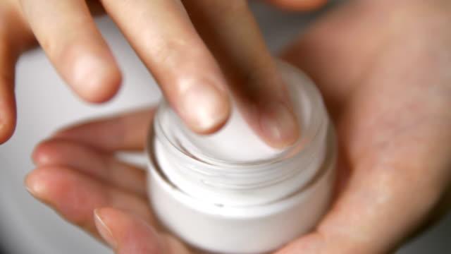 skin care,finger touching moisturizer cream - jar stock videos & royalty-free footage