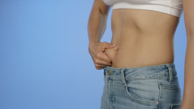 skin versus fat, know the difference - waist stock videos & royalty-free footage