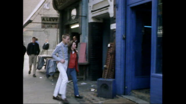 skinhead couple enter a well-known skinhead shop; 1980 - hairstyle stock videos & royalty-free footage