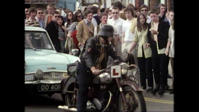 skinhead in german military helmet rides motorbike; 1980 - sports helmet stock videos & royalty-free footage