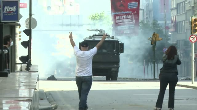 Skirmishes between police and protesters continue in the streets of Istanbul after police used tear gas and water cannons to clear out the citys Gezi...