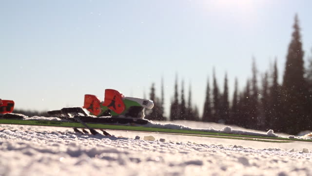 Skis hitting the ground as skier straps boots in.  - 1920x1080