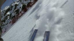 POV Skis leaving a snow powder trail behind them