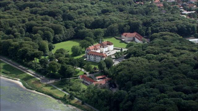 skive and krabbesholm manor  - aerial view - central jutland,  skive kommune,  denmark - sports period stock videos & royalty-free footage