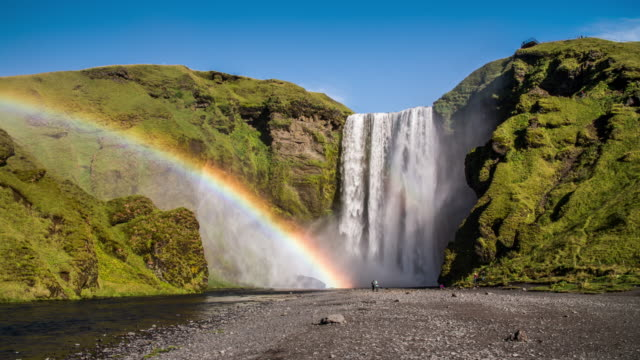skogafoss waterfall, iceland - dramatic landscape stock videos & royalty-free footage