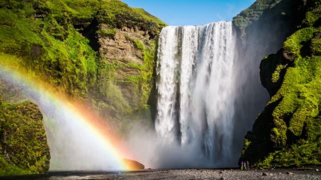 skogafoss waterfall with rainbow in iceland - waterfall stock videos & royalty-free footage