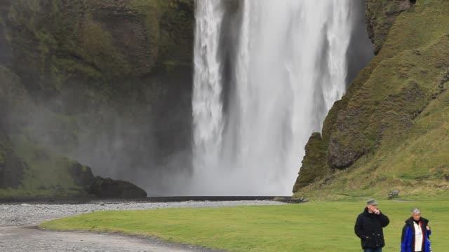 skogarfoss waterfall on iceland's south coast at skogar. - drop stock videos & royalty-free footage