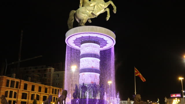 skopje, night view of the fountain with alexander the great statue, in the macedonia square. - skopje stock videos and b-roll footage