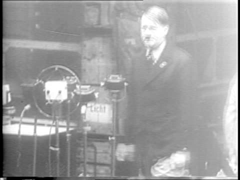 vídeos de stock, filmes e b-roll de skull and swastika / adolf hitler salutes / hitler speaks on stage before a crowd / joseph goebbels / rudolph hess / heinrich himmler / herman... - 1945