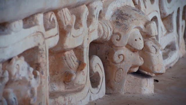 skull at ek balam mayan ruins - carving craft product stock videos & royalty-free footage