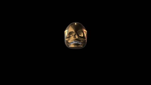 stockvideo's en b-roll-footage met schedel decoratie kunst voor het eten van goud - hersenhelft