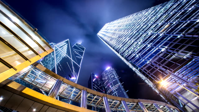 Sky and illuminated skyscrapers in hong kong.Time lapse.