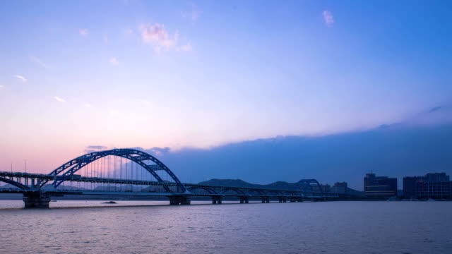 sky and traffic on bridge and river in hangzhou,dusk to night.hyperlapse. - dusk to night stock videos and b-roll footage