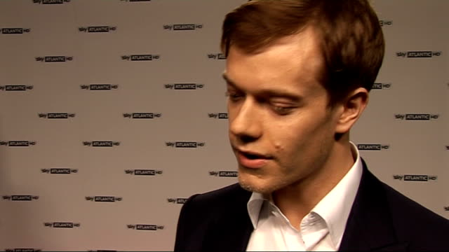 red carpet interviews; alfie allen posing for photocall alfie allen interview sot - on starring in game of thrones, coming out in april, haven't seen... - lily family stock videos & royalty-free footage