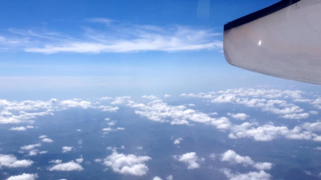 Sky cloud view through an airplane window.