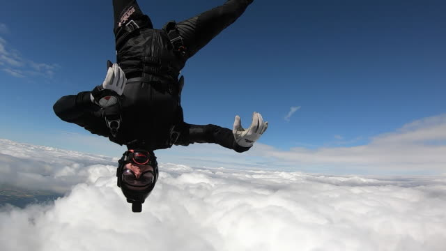 sky diver in free fall flying through clouds - skydiving stock videos & royalty-free footage