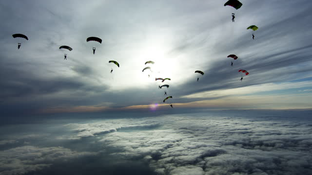 sky filled with parachutes - parachute formation skydivers - clear sky stock videos & royalty-free footage