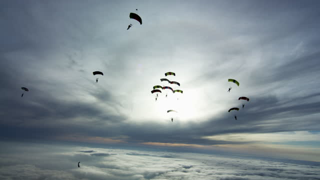 sky filled with parachutes - parachute formation skydivers - 50 59 years stock videos & royalty-free footage