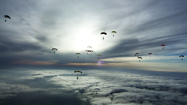 sky filled with parachutes - parachute formation skydivers - 30 39 years stock videos & royalty-free footage