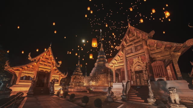 slo mo sky lantern at wat phra sing temple in loi krathong traditional festival. - chiang mai province stock videos & royalty-free footage
