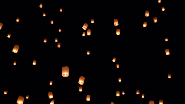 slo mo sky lantern in the sky - tilt up stock videos & royalty-free footage