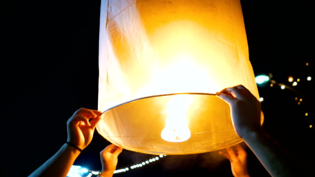 sky lantern loi krathong and yi peng traditional festival, chiang mai province, thailand - paper lantern stock videos & royalty-free footage