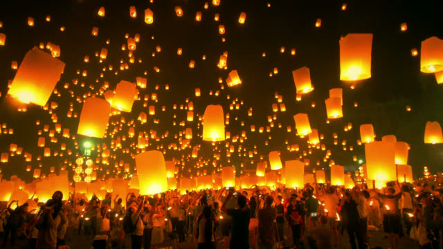sky lantern loi krathong traditional festival. - mid air stock videos & royalty-free footage