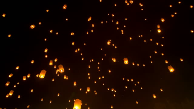 sky lantern loi krathong traditional festival. - candle stock videos and b-roll footage