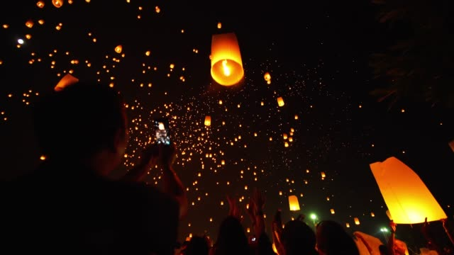 sky lantern loi krathong traditional festival. - balloon stock videos and b-roll footage