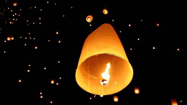 sky lanterns during festival in chiang mai thailand - sky lantern stock videos & royalty-free footage