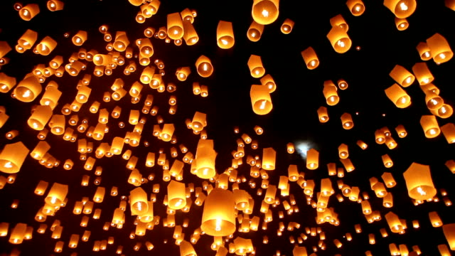 sky lanterns during yee peng festival in chiang mai thailand - floating on water stock videos & royalty-free footage