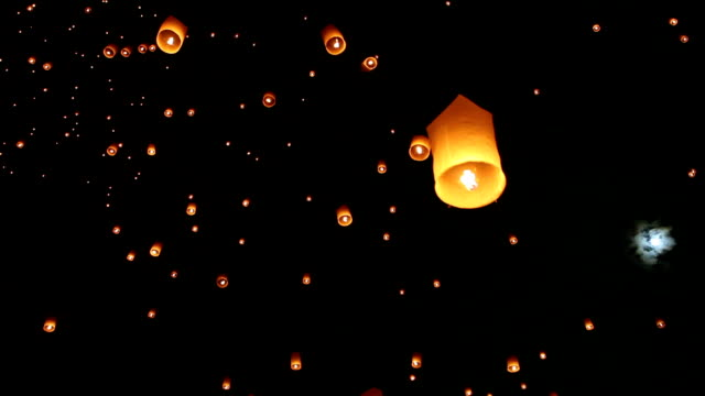 sky lanterns for yee peng festival in chiang mai thailand - lantern stock videos & royalty-free footage