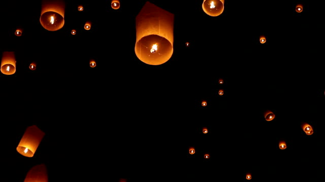 sky lanterns in chiang mai thailand - paper lantern stock videos and b-roll footage