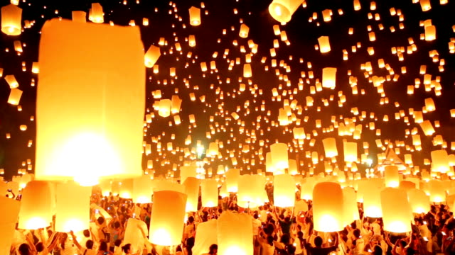 sky lanterns in yee-peng festival. - paper lantern stock videos and b-roll footage