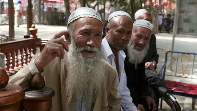 sky news gains rare access to china's far western xinjiang province next to afghanistan/pakistan shows exterior shots of local muslim uighur men... - xinjiang province stock videos & royalty-free footage