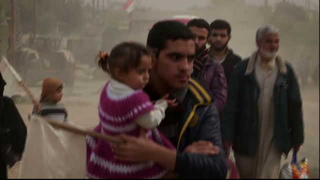 sky news has witnessed first hand the dangers being faced by thousands of people trapped in the fighting in mosul and desperate to escape nearly... - mosul stock videos and b-roll footage